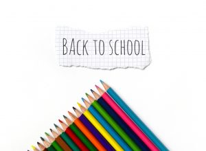 Back to school note with colored pencils